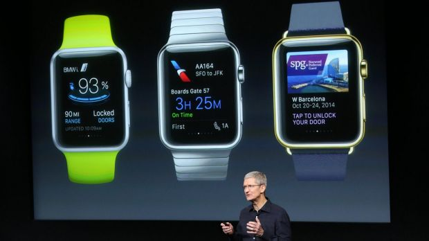 Apple chief Tim Cook stands in front of a screen displaying apps that will be available for the Apple Watch.