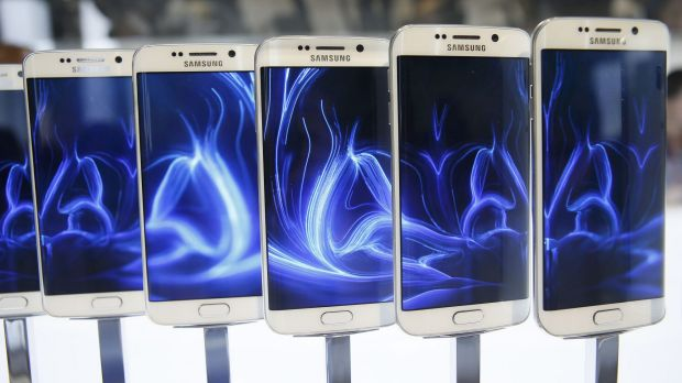 A row of Galaxy S6 edge smartphones on display before the Mobile World Congress in Barcelona.