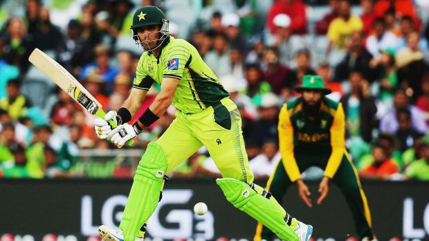 Average total: Misbah ul Haq of Pakistan works the ball away for a single.