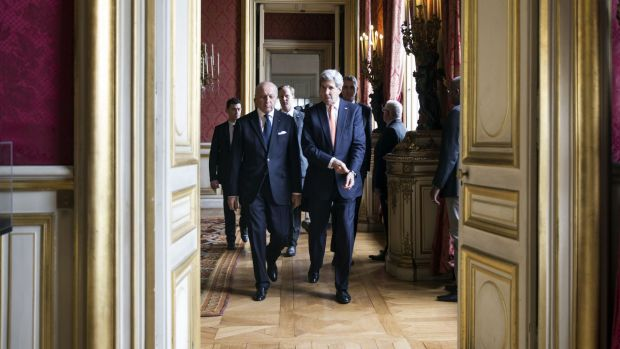 French Foreign Affairs Minister Laurent Fabius and US State Secretary John Kerry arrive at the French Foreign Affairs ...