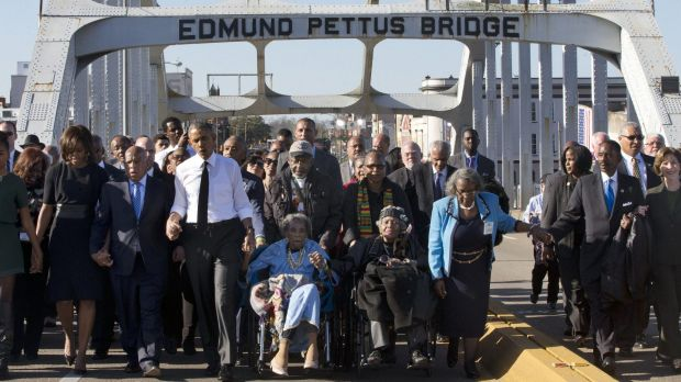 Singing <i>We shall overcome</i>, marchers in Selma led by President Barack Obama commemorate the 50th anniversary of ...