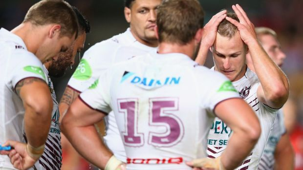 Long season ahead: Daly Cherry-Evans looks dejected after another Eels try on Friday night.