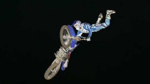 Local Bundaberg rider Clinton Moore defying gravity with his freestyle MX.