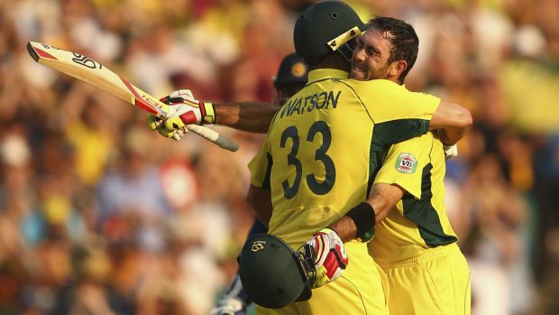 Smash and grab: Shane Watson congratulates Glenn Maxwell in a bear hug after his remarkable innings.