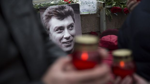 Mourners lay flowers and candles at the spot where Boris Nemtsov was gunned down.