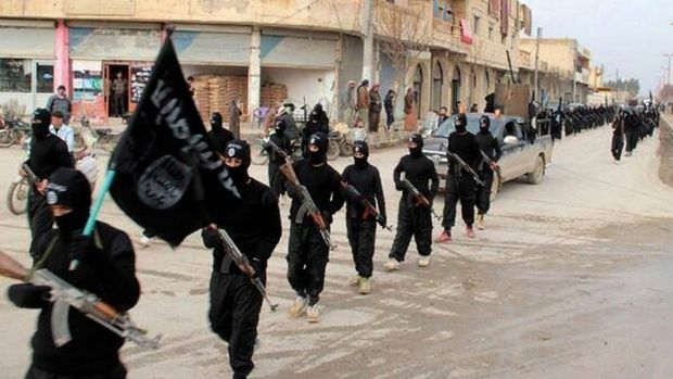 This undated photo posted on a militant website shows fighters from Islamic State marching in Raqqa, Syria.