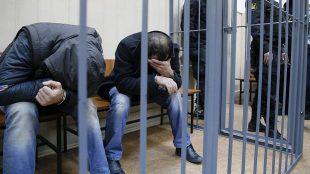 Shagid Gubashev and Ramzan Bakhayev hide their faces at court on Sunday.