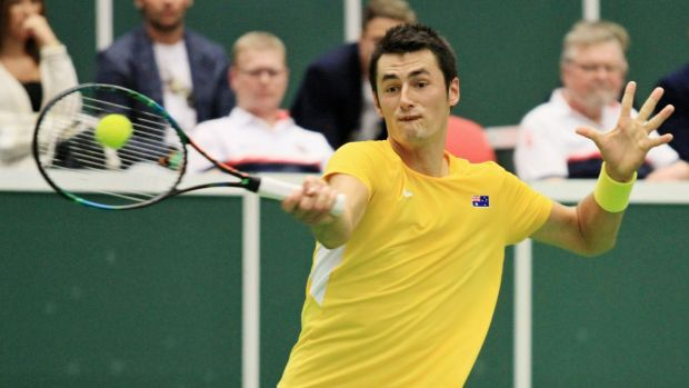 Australia's Bernard Tomic in action against Czech Republic's Lukas Rosol on Sunday.