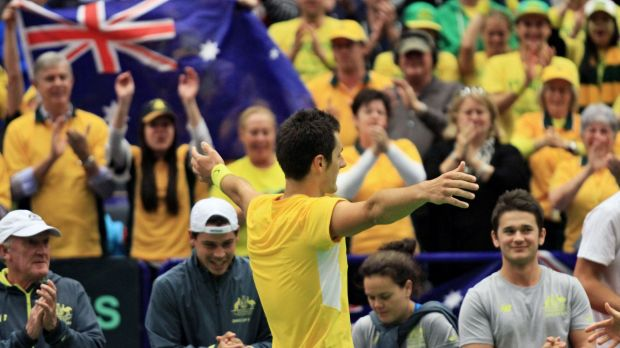 Bernard Tomic savours victory after Australia claim a 3-1 Davis Cup win over Czech Republic in Ostrava.