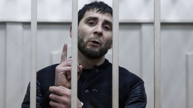 Zaur Dadayev, charged with the murder of Boris Nemtsov, inside a defendants' cage in Moscow.