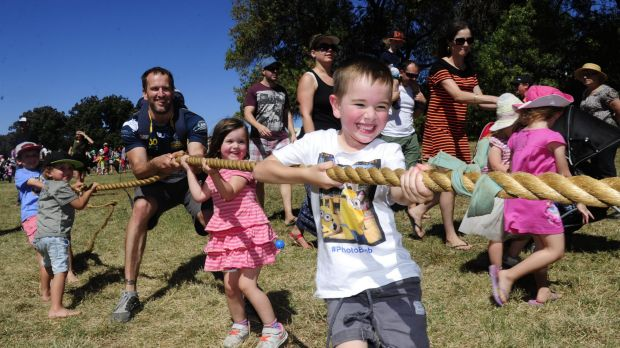 Playing tug-of-war, Paul Teede of Weston with his kids Ethan, 5, and Heidi, 3.