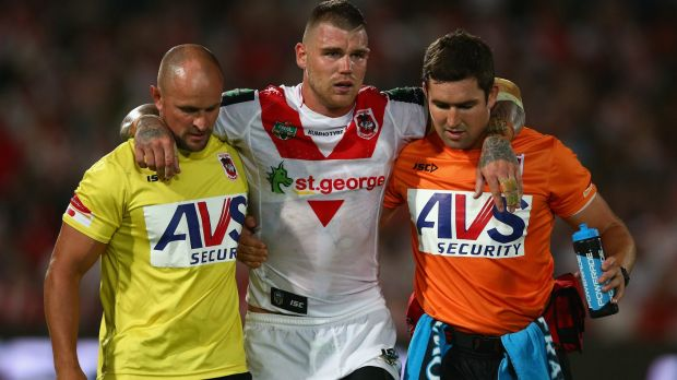 Ankle problem: Dragons fullback Josh Dugan is helped from the field in round one.