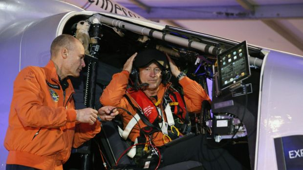 Epic flight ... Swiss pilot Andre Borschberg (right) and his compatriot pilot Bertrand Piccard get ready to fly the ...