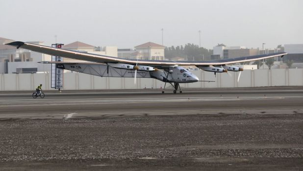 The Solar Impulse 2 takes off at Al Bateen airport in Abu Dhabi at the start of an attempt to fly around the world in ...