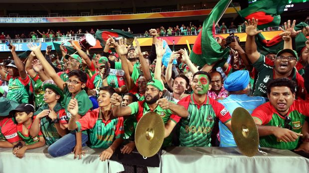 Bangladesh supporters celebrate after their country's World Cup defeat of England at Adelaide Oval on Monday.