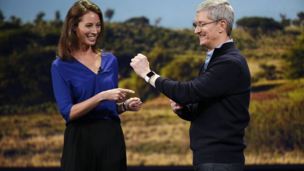 Apple CEO Tim Cook shows of the Apple Watch and model Christy Turlington Burns  in March.