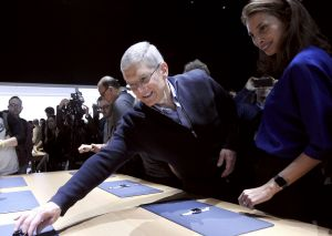 Apple CEO Tim Cook reaches for an Apple Watch to show to model Christy Turlington Burns during the Apple event in San ...