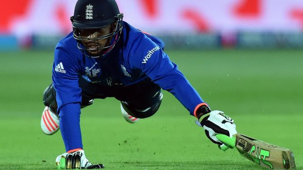 England's Chris Jordan tries to make his ground but was given out.