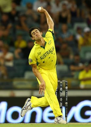 Over she goes: Mitch Starc bowls during the match against Afghanistan.