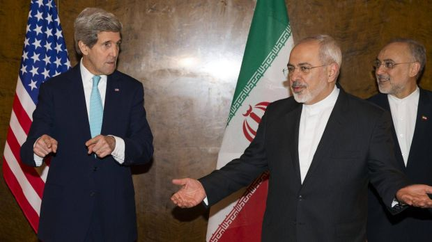 US Secretary of State John Kerry (left) and Iran's Foreign Minister Mohammad Jawad Zarif (centre) resume nuclear ...