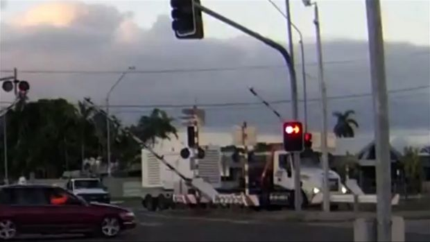 A truck crashes through a boom gate at a Townsville level crossing.