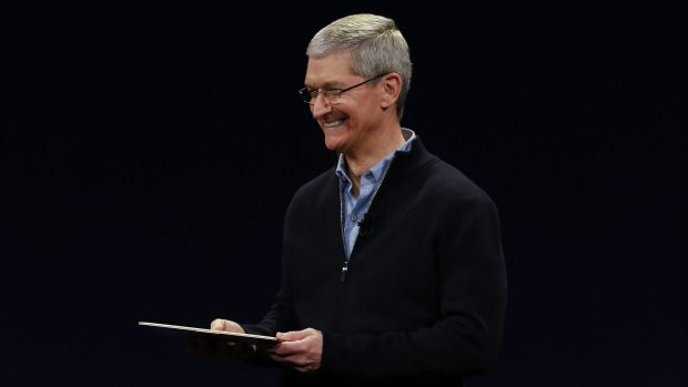 Apple CEO Tim Cook introduces the tiny machine.