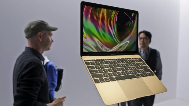 Members of the media and Apple guests get a look at the new MacBook.