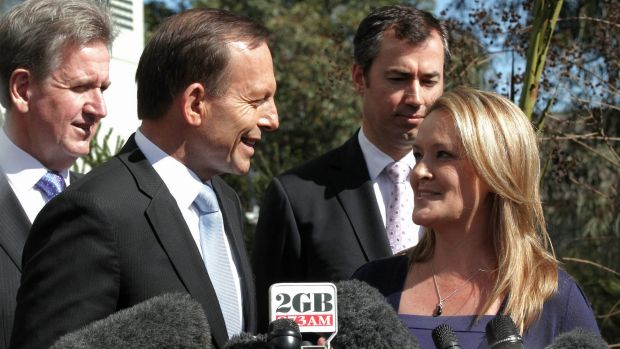 Happier times: Tony Abbott with Fiona Scott during the election campaign in 2013.