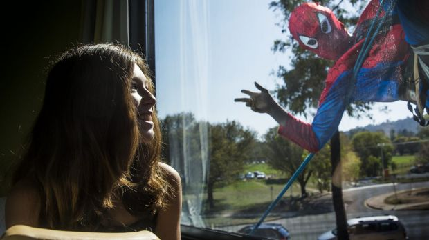 Kaylah Field, 12, gets a visit from Spiderman.