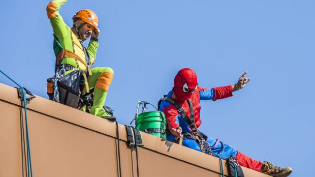 Rope Access Engineering employees Clifford Bourke and Time Greschke dress up to entertain the children at Canberra Hospital.