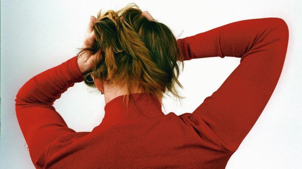 Tearing your hair out at work? Try standing up, stretching or going for a short walk.