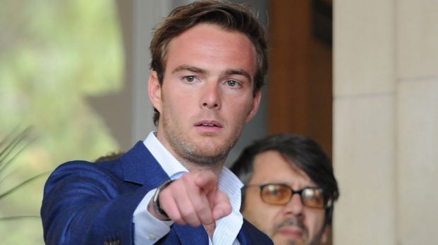 Dutch driver Giedo van der Garde leaves court on Wednesday.