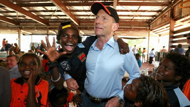 Prime Minister Tony Abbott with excited school children at Yirrkala School during his visit to North East Arnhem Land in ...
