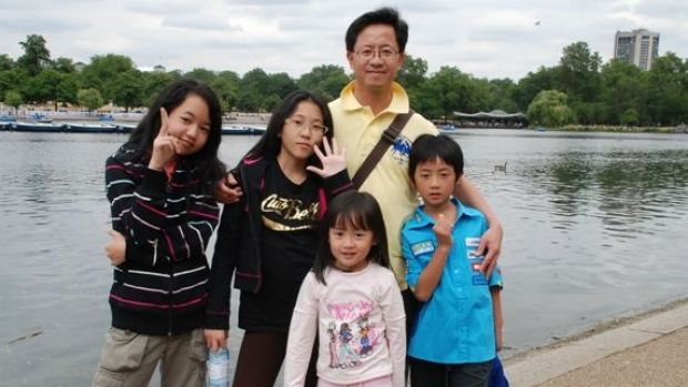 Matthew Ng with his four children before he was jailed in China.