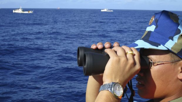 A crewman from a Vietnamese coastguard ship watches Chinese coastguard vessels  in the South China Sea last year.  Japan ...