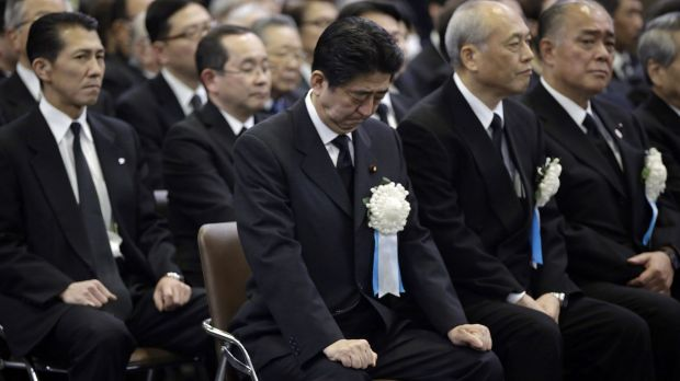 Japanese Prime Minister Shinzo Abe attends the Tokyo firebombing memorial service on March 10. He has plans to amend ...