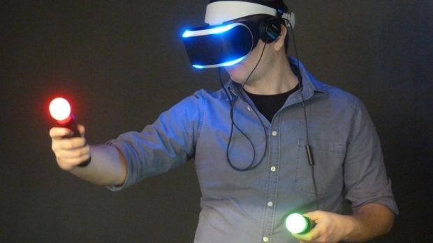 Sony's Project Morpheus headset, shown here with two of the company's motion-sensing Move controllers.
