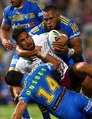 Suspended: Junior Paulo (top) and Isaac De Gois tackle Jesse Sene-Lefao on Friday night.