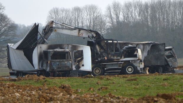 The burnt out vans are seen near the Avallon motorway exit, central France.