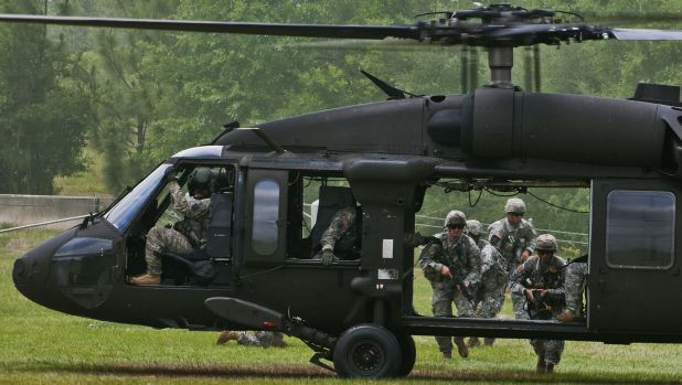 US Army Rangers make their way to a UH-60 Black Hawk at Eglin Air Force Base, Florida.  Seven US Marines and four ...