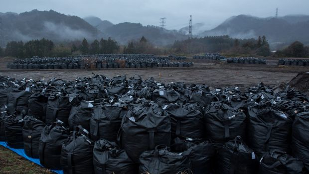 Bags of soil contaminated with radiation are stacked in Tomioka, Fukushima prefecture.