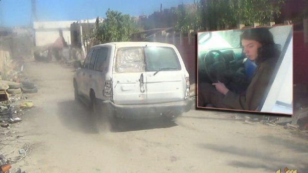 A television screenshot of one of the cars reportedly involved in a suicide bombing and (inset) a youth who bears a ...