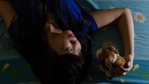 """Cash cows"": Nur'Asiah, a sex worker in her room in Indramayu, West Java."