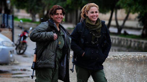 Young women guard the Asayish (Kurdish intelligence agency) headquarters in Tel Tamer, where Islamic State militants had ...