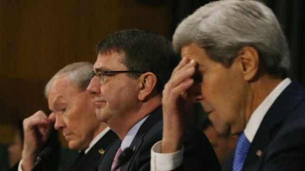 US Secretary of State John Kerry, right, flanked by Defence Secretary Ashton Carter and General John Dempsey, left, ...