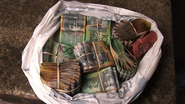 A witness in a murder investigation has been jailed after hiding $1.8 million in alleged drug money and refusing to ...