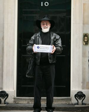 Pratchett outside No. 10 Downing Street, London, in 2008. He was handing in a petition calling for an increase in ...