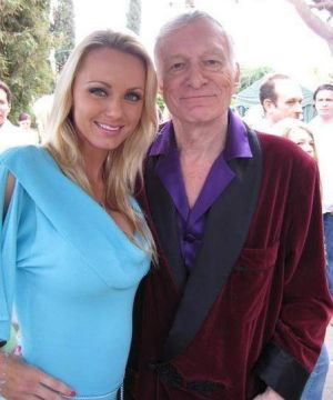 Playmate Cassandra with Hugh Heffner.