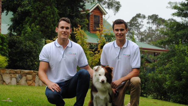 Barking Orders' founders Ryan and Jarryd Boyd with their border collie Ned.