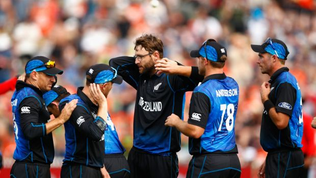 Well placed: Nathan McCullum, Brendon McCullum and Daniel Vettori of New Zealand swipe away bugs during the clash ...